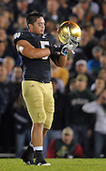 Manti Te'o (5) adjusts his helmet in the second quarter against USC at Notre Dame Stadium.