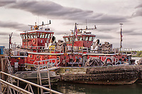 Red tugboats docked at the harbor in Portsmouth, New Hampshire