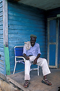 Paul, local man in front of his house, Cat Island,  Bahamas