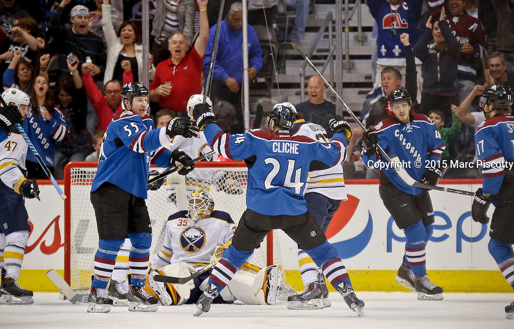 SHOT 3/28/15 7:24:12 PM - The Colorado Avalanche's Marc-Andre Cliche #24 celebrates after scoring against the Buffalo Sabres during their regular season NHL game at the Pepsi Center in Denver, Co. The Avalanche won the game 5-3. (Photo by Marc Piscotty / © 2015)