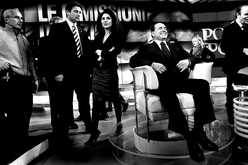 """Italian Prime Minister Silvio Berlusconi smiles as he prepares to star at the italian """"RAI"""" studios in a politic talk show.The italian politics leader made his first TV appereance after 8 months, to draw a balance of his five years government and to welcome the resignation of Bank of Italy Governor Antonio Fazio."""