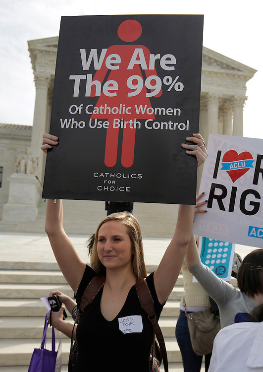 Supporters of contraception rally before Zubik v. Burwell, an appeal brought by Christian groups demanding full exemption from the requirement to provide insurance covering contraception under the Affordable Care Act, is heard by the U.S. Supreme Court in Washington March 23, 2016.      REUTERS/Joshua Roberts