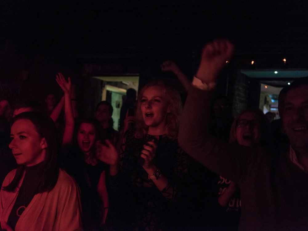 People attend a concert of the band Recha at TNT Rock Club on Tuesday, November 24, 2015 in Minsk, Belarus.