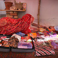 Suitcases are packed for Sarita, 15, and Maya, 8, who were married the previous day to bridegrooms Hariprasad, 22, and Kishore, 13, Rajasthan, India, April 29, 2009. The ceremony took place on the Hindu holy day of Akshaya Tritiya, called Akha Teej in north India. Despite legislation forbidding child marriage in India, such as the Child Marriage Restraint Act-1929 and the much more progressive Prohibition of Child Marriage Act of 2006, marrying children off at a very tender age continues to be accepted by large sections of society.