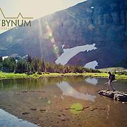 woman hiker alpine lake preston park glacier national park montana