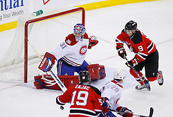 Jan 21, 2008; Newark, NJ, USA; Montreal Canadiens goalie Carey Price (31) makes a save on New Jersey Devils left wing Zach Parise (9) during the third period at the Prudential Center. The Devils defeated the Canadiens 5-2.