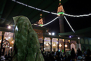 A Shi'a woman prays at the Khadamiyah Shrine September 04, 2010 in Baghdad, Iraq. An intense power struggle between Iraq's Shia political leaders and parties is one of the main obstacles to the formation of a new government since the inconclusive March 2010 poll, according to senior Iraqi officials involved in ongoing negotiations. Credit: Scott Nelson for the Wall Street Journal.Slug: Iraq - Shia divisions.