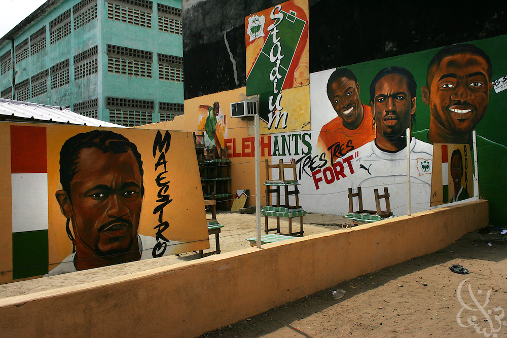 A local cafe is decorated with a national team murals in the Yopoungon  neighborhood of Abidjan, Côte d'Ivoire February 19,2006.   Football is an integral part of the social fabric of the Côte d'Ivoire.