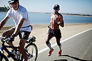 Meb Keflezighi on a training run with Richard Levy on Fiesta Island in San Diego, CA on Tuesday, September 16, 2014.  The field in New York for the Marathon will be as strong as ever and will include the defending champion Geoffrey Muttai and the world record holder Wilson Kipsang, but its historically been Meb's strongest race.