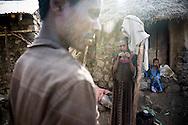 Menso Gebru, 40, Mulu Girma, 28, and Yalem Menso, 4, at home in Adi Sibhat, Tigray, Ethiopia.