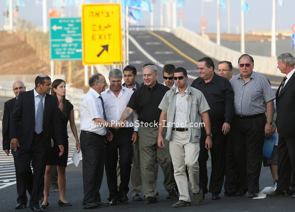 Israeli Prime Minister Benjamin (Bibi) Netanyahu (also Binyamin Netanyahu, born 21 October 1949) at a cutting of a ribbon ceremony November 11 2012. On his left is the Minister of Transport Yisrael Katz