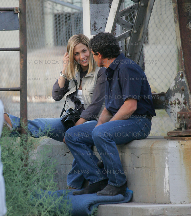 "July 22, 2005 Albuquerque, New Mexico **EXCLUSIVE** Jennifer Lopez and Antonio Banderas on the New Mexico set of ""Bordertown"". Lopez and Banderas film some serious scenes but then laugh and smile in between takes. Lopez and Banderas's characters play reporters who go undercover in Juarez, Mexico to investigate the rapes and murders of women who work in factories (based on a true story). Sales: Eric Ford 1/818-613-3955 info@onlocationnews.com"