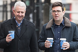 """© Licensed to London News Pictures. Manchester , UK . FILE PICTURE DATED 07/01/2017 of IVAN LEWIS MP and ANDY BURNHAM carrying Caffe Nero coffees when arriving for a campaign launch event for Andy Burnham's candidacy of Mayor of Greater Manchester, at the Mechanics' Institute in Manchester. Mr Burnham wrote on twitter """" Bit bizarre hearing these right-wing calls for a 'Barista Visa'. God forbid the idea of waiting longer in the morning for their posh coffee """". Photo credit: Joel Goodman/LNP"""