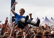 A music fan crowd surfs on a camping chair as The View performs live on the Main Stage during day three of Reading Festival 2011 on August 28, 2011 in Reading, England.  (Photo by Simone Joyner)
