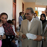 Dr. Ibrahim Abouleish, founder of Egyptian Organic Food and Product giant Sekem Group jokes with a small girl at the Sekem Farms Medical Center Nov 4, 2008 at the large Sekem Farms complex in Belbeis, Egypt. Dr. Abouleish founded his organic food business in 1977 with the intent of creating a lasting series of positive community building ideas.