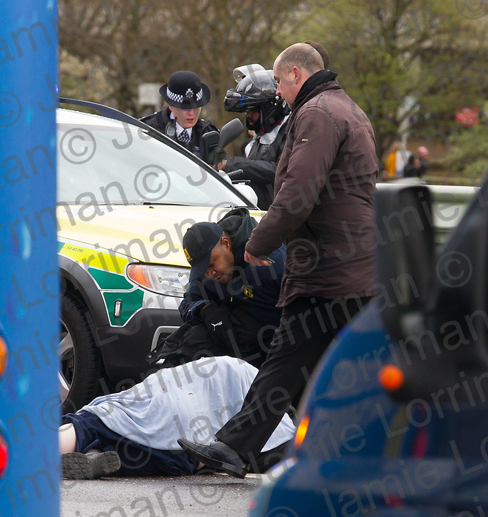 Terrorist incident on Westminster Bridge, London<br /> <br /> Pictured: Medics treat a victim on Westminster Bridge, London<br /> <br /> Jamie Lorriman<br /> mail@jamielorriman.co.uk<br /> www.jamielorriman.co.uk<br /> 07718 900288