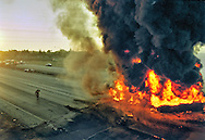 A double-diesel tanker exploded in a fiery crash, September 12, 1995 on westbound US 50 and Howe Ave. Sacramento firefighters had to wait until most of the 8,000 gallons of fuel <br />