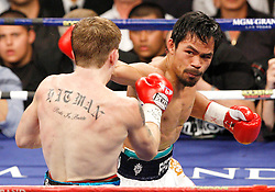 May 2, 2009; Las Vegas, NV, USA; Manny Pacquiao (white trunks) knocks out Ricky Hatton in the 2nd round of their bout at the MGM Grand Garden Arena in Las Vegas, NV.  Copyright Ed Mulholland/HBO  NO SALES