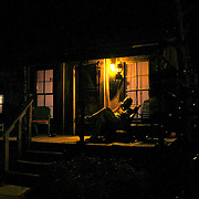 Who Owns the Blues? - Californian Scott Harris enjoys a quiet night on the porch of his shanty while soaking up the inspiration of the Mississippi Delta. He is a beginner learning to play the blues harp as a hobby at  Harmonica Jam Camp in Clarksdale, Mississippi.