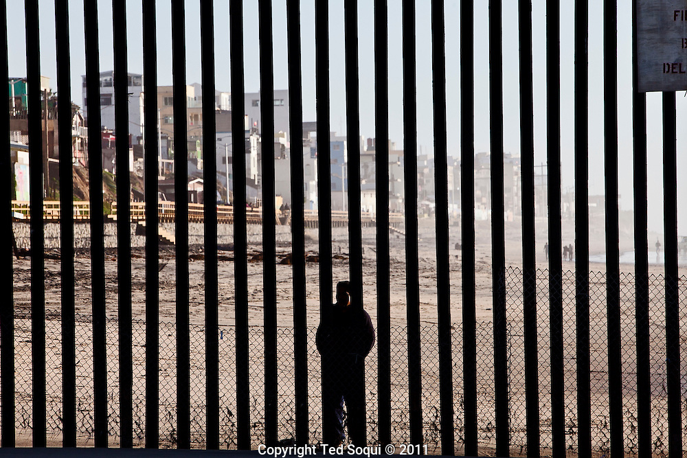 The rusty border fence that separates the U.S and Mexico extends briefly in to the Pacific Ocean. The once porous beach border area is now highly patrolled by U.S. Border Patrol, with very few Mexican immigrants making their passage in to the U.S..