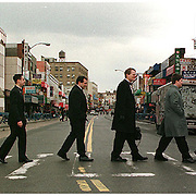 A groom and his groomsmen recreate Abbey Road as they play around in Brooklyn before the wedding ceremony.