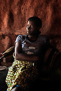 Kartu Village, Zimbabwe. November, 2012. Regina is the sixteen year old daughter and caretaker of Dinas. Dinas broke her neck and is paralyzed. Regina may be finished school.