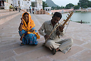 India, Rajasthan, Pushkar Playing music on the shore of the lake