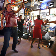 "Who Owns the Blues? - Dancers swing and sway to the sensual blues rhythms, while Willie ""Big Eyes"" Smith plays some authentic blues harmonica at the Hopson Plantation in Clarksdale, Mississippi. He says it is his job to help keep the blues alive. They were at a tribute to Pinetop Perkins and a celebration of his life following his burial in March. Smith passed away later in 2011 as well. Many of the original great Mississippi bluesmen are dying off."