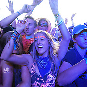 Fans dance and cheer DJ Snake at the Bass Camp stage at the Pemberton Music Festival.  Pemberton BC, Canada