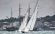 Image licensed to Lloyd Images <br /> Aberdeen Asset Management Cowes Week 2015. Day 1 of racing in the Solent. Picture shows the Etchells fleet crossing the start line close to the Cowes shoreline this afternoon<br /> Credit: Lloyd Images