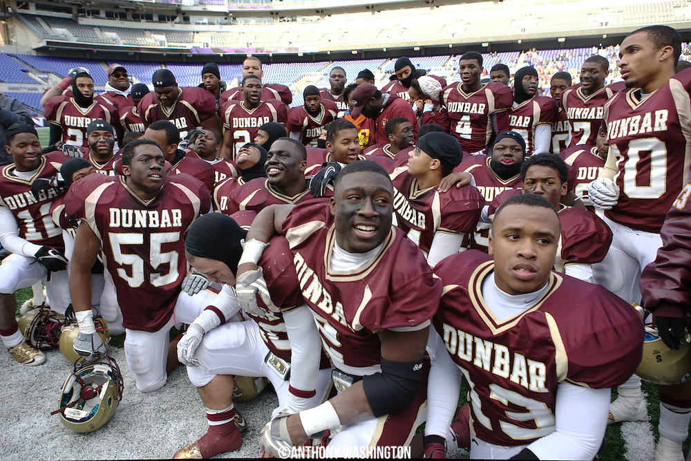 The Dunbar High School football team huddles together following the class 1A MPSSAA 2010 State Football Championship game at M&T Bank Stadium in Baltimore, MD on Saturday, December 4, 2010.