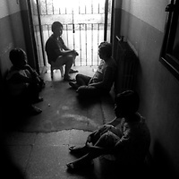 BEIJING,JUNE-14:: female patients sit in the corridor of a mental hospital in beijing to pass time..Often ,standards in China's mental hospitals are low and there is no adequate treatment or therapy for mentally disturbed patients.