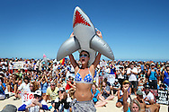 CATEGORY 3<br />Paul Kane<br />Getty Images<br />A protestor shows her support during a shark-culling policy protest at Cottesloe Beach.