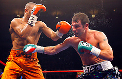 Nov 8, 2008; New York, NY, USA; Joe Calzaghe and Roy Jones Jr. trade punches during their 12 round Light Heavyweight Championship fight at Madison Square Garden in New York, NY.  Calzaghe won via unanimous decision.