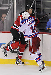 May 21, 2012; Newark, NJ, USA; New York Rangers right wing Marian Gaborik (10) hits New Jersey Devils left wing Alexei Ponikarovsky (12) during the second period in game four of the 2012 Eastern Conference Finals at the Prudential Center.