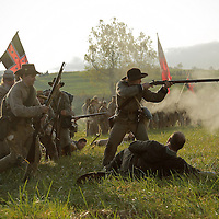 Confederate soldiers advance toward the Union line during a sunrise reenactment of Donelson's Attack, part of a weekend of events commemorating the 150th anniversary of the Battle of Perryville in Perryville, Ky. Saturday October 6, 2012.  Photo by David Stephenson