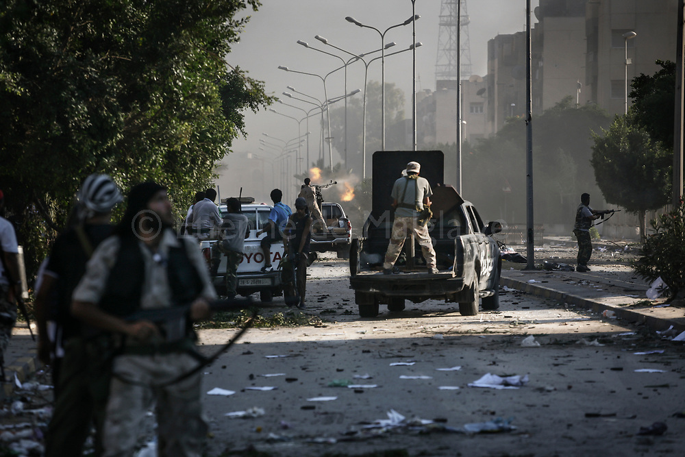 Rebels say they control most of Tripoli, but they faced pockets of fierce resistance from regime loyalists in Abu Salim district where Gadhafi's snipers were shooting back. 25 August 2011.