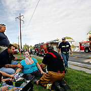 Rick Kind of Richland comforts his wife Melissa as firefighters tend to her for smoke inhalation after a fire at the duplex at 1436 Thayer Dr. burned the unit inhabited by neighbors Anngelina Chasteen, left, and her fiance Casey Schimel. The Kinds' home suffered extensive smoke damage and Melissa and their daughter Alexa, 3, were transported to Kadlec Medical Center for smoke inhalation.