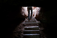Syria. A FSA fighter is seen as he is exiting a cave used as shelter by the Free Syrian Army in a village in Aleppo's province. ALESSIO ROMENZI