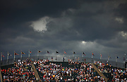 """SHOT 8/4/10 4:02:43 PM - Fans in the """"Rockpile"""" section take in the Colorado Rockies versus the San Francisco Giants during their regular season game at Coors Field in downtown Denver, Co. as storm clouds threaten in the background. The Rockies won the game 6-1. (Photo by Marc Piscotty / © 2010)"""
