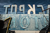 Blue and white motel sign