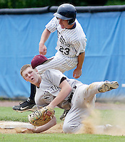 Kingston first baseman Matt Fletcher collides with Pine Bush's Andrew Overton (23) while reaching for the ball during the Section 9 Classs AA baseball championship game at SUNY New Paltz on Friday June 1, 2012.