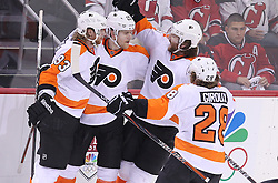 May 3, 2012; Newark, NJ, USA;  The Philadelphia Flyers celebrate a goal by Philadelphia Flyers defenseman Matt Carle (25) during the second period in game three of the 2012 Eastern Conference semifinals at the Prudential Center.