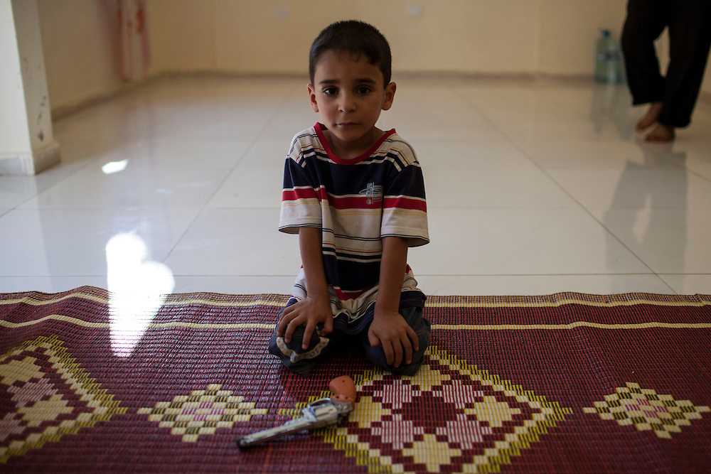 05/07/2013 near Damour, Lebanon:A young Syrian boy with a toy gun. Estimates have placed the number of Syrian refugees in Lebanon at well over 500,000 people.