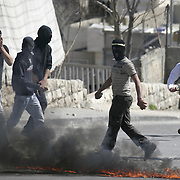 Palestinian stone-thrower during clashes with Israeli security forces in the east Jerusalem neighborhood of Silwan, Friday, March 4, 2011.  Photo by Oren Nahshon.