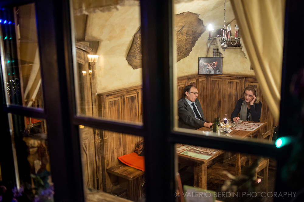 A couple in a restaurant by the Prague Castle in Mala Strana.