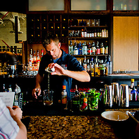 "WINTER PARK, FL -- Barkeep Mike Bass serves up a ""Fully Realized"" (Bulliet rye whiskey, cherry herring, campari, Orange & Fee Bros. black walnut bitters) at Cask & Larder in Winter Park, Florida.  (PHOTO / Chip Litherland)"