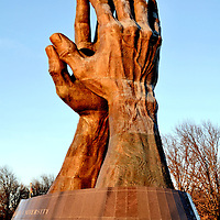 World's Largest Praying Hands Statue at Oral Roberts University in Tulsa, Oklahoma<br /> World's Largest Praying Hands Statue at Oral Roberts University in Tulsa, Oklahoma<br /> At the entrance of Oral Roberts University, founded in 1963 by the famous evangelist, are the World&rsquo;s Largest Praying Hands. The religious artwork is seen here at sunset. The bronze sculpture was created by Leonard McMurry and cast in Mexico in 1980. It was then sent to Tulsa, Oklahoma, in 450 pieces and erected in front of the City of Faith building. Nine years later, it was relocated to the Avenue of Flags, now called Billy Joe Daugherty circle. The sculpture is 60 feet tall and weighs 30 tons.