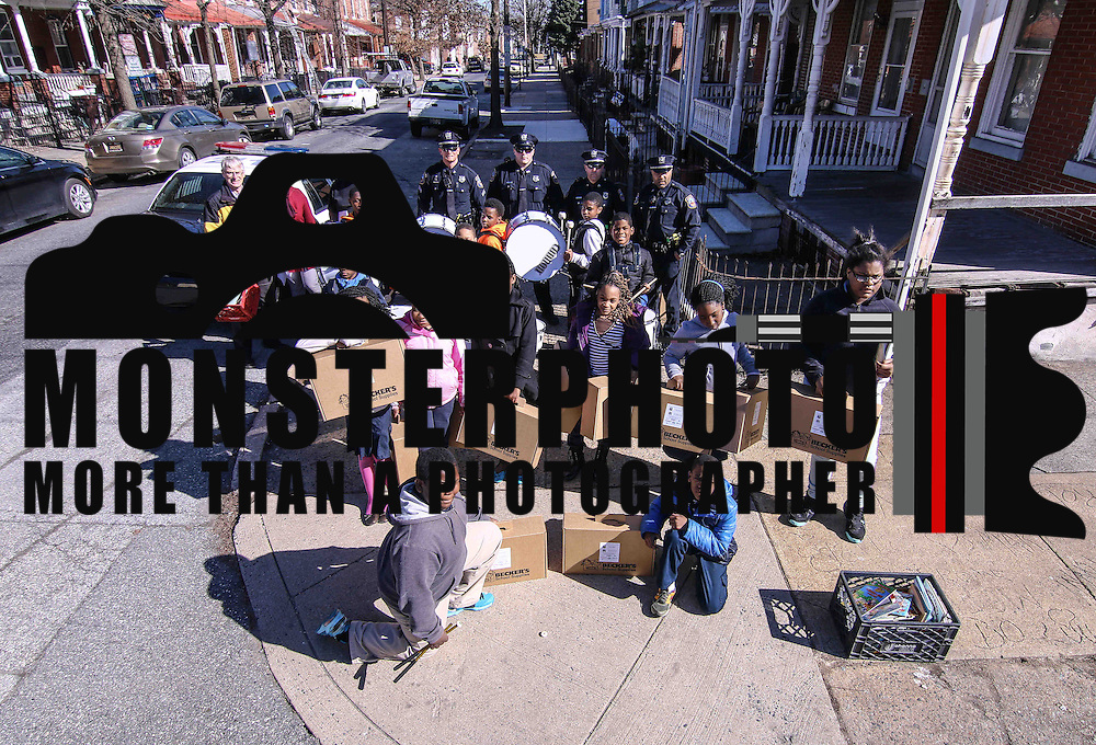 Students from Stubbs and Bancroft Elementary School prepare to pose for a group photo with Officers from the Wilmington Police Department on North Lombard Street Wednesday, Mar. 18, 2015 in Wilmington, DE.