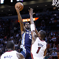12 March 2011: Memphis Grizzlies shooting guard O.J. Mayo (32) goes for the layup against Miami Heat power forward Chris Bosh (1) during the Miami Heat 118-85 victory over the Memphis Grizzlies at the AmericanAirlines Arena, Miami, Florida, USA. **